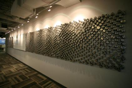 Impact wall for a canister company